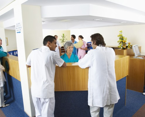 Hospital Staff at Reception Desk