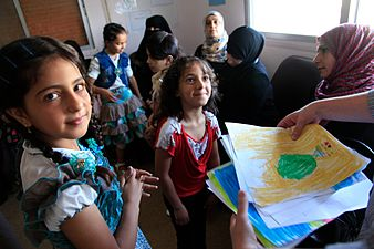 Refugee_children_from_Syria_at_a_clinic_in_Ramtha,_northern_Jordan_(9613477263)-1