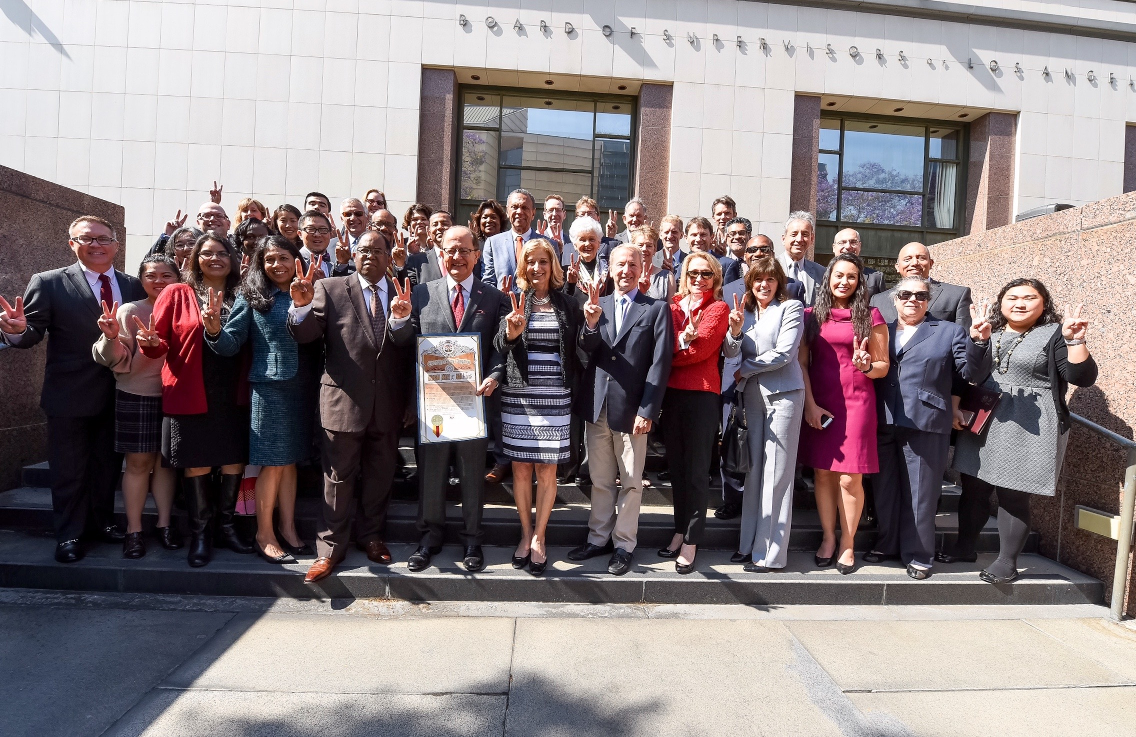 USC students, alumni and officials with President Nikias and Supervisor Ridley-Thomas