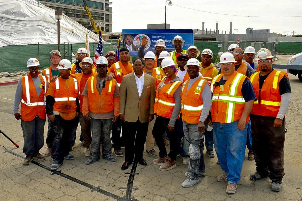 Supervisor Mark Ridley-Thomas with workers during the construction of Martin Luther King, Jr. Community Hospital, which implemented a local worker hire program.
